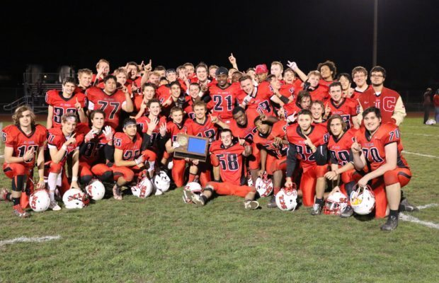 The St. Croix Lutheran football team poses with their sectional championship trophy after beating Patrick Henry High School last week. St. Croix features 6 Brazilian student-athletes in its 9-12  grade football program.
