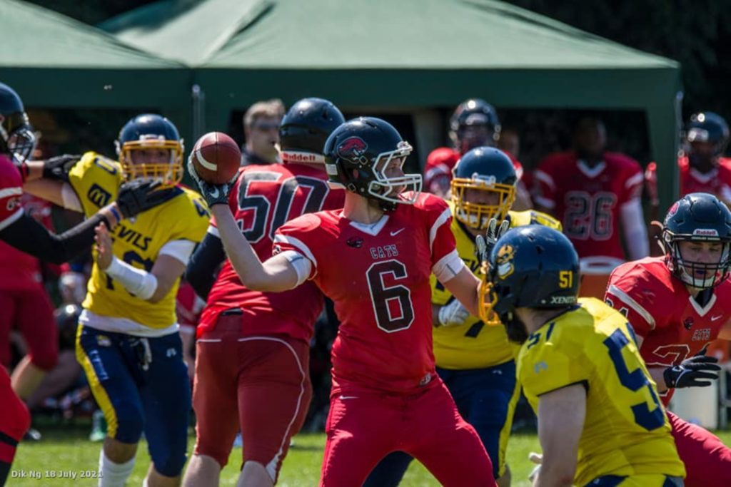 Great-Britain-2021-Cambridgeshire-Cats-QB-winding-up-to-throw-against-the-Norwich-Devils-Photo-Dik-Ng-1024x683.png
